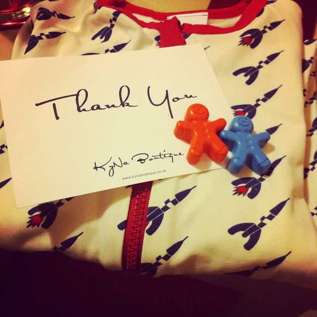 Thanks @kynaboutique - we love Toby's new rocket romper (and the gingerbread man crayons too) x