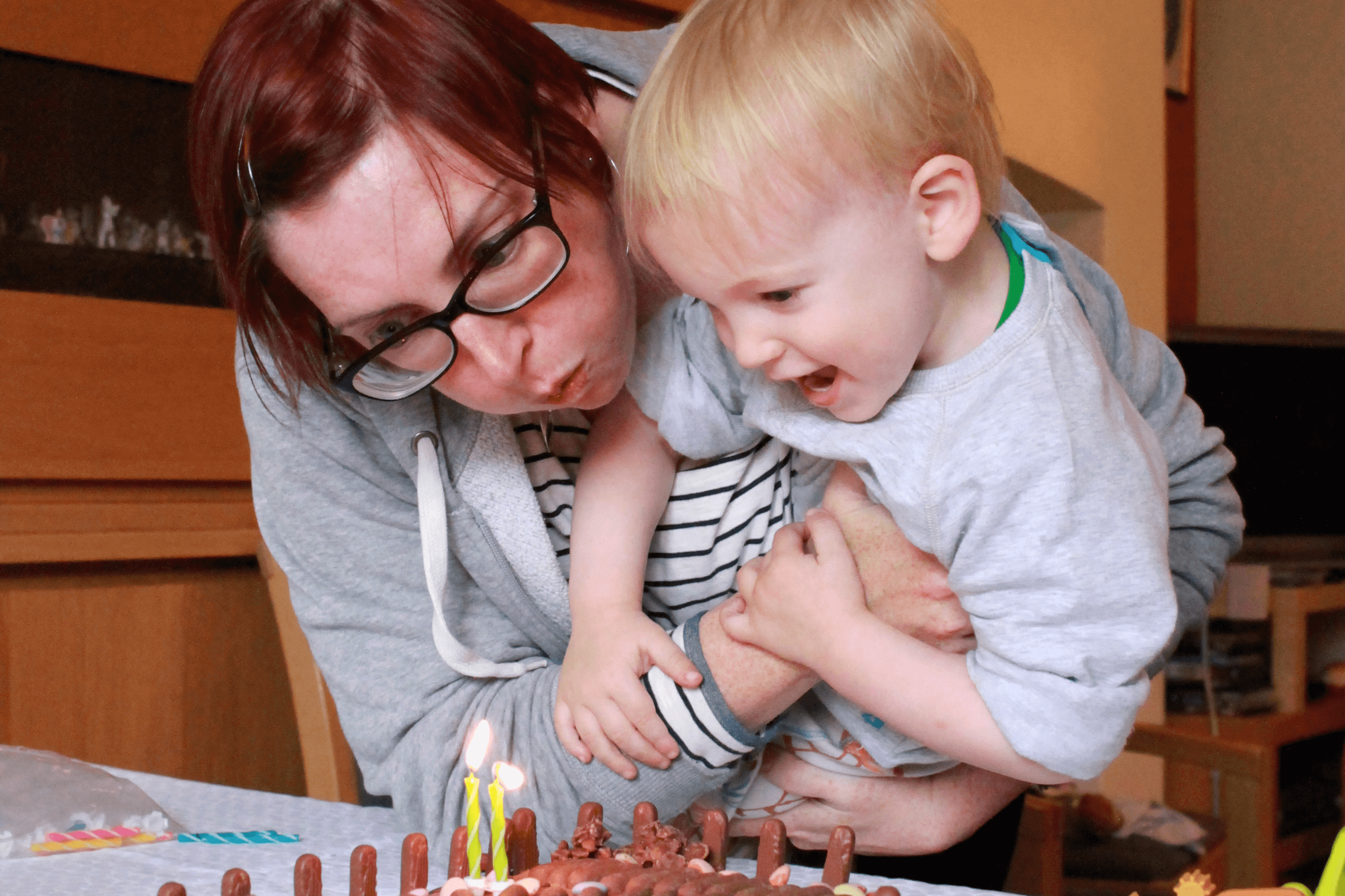 Gabe and mummy blowing out the birthday candles
