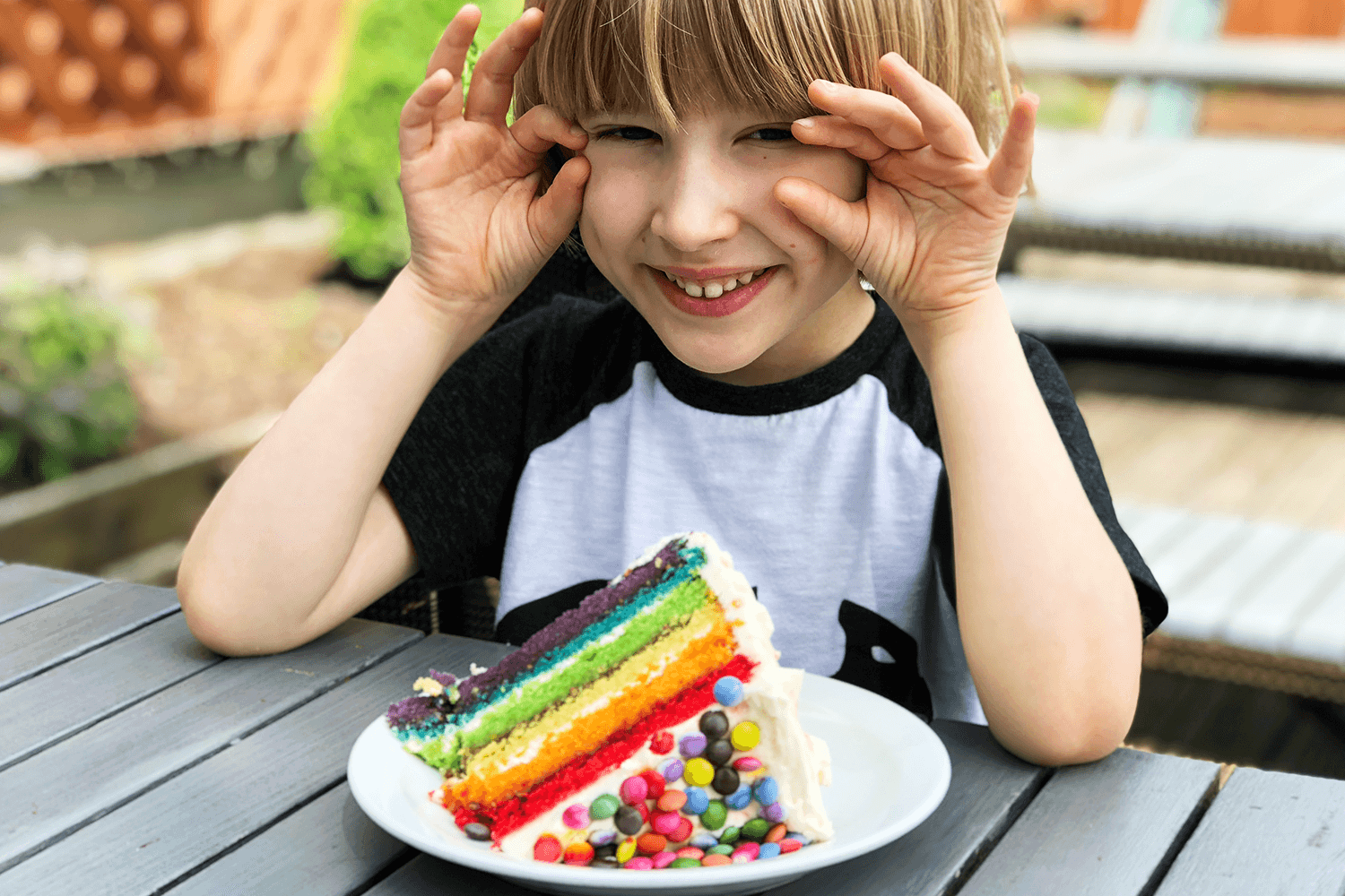 Toby with his enormous slice of rainbow cake