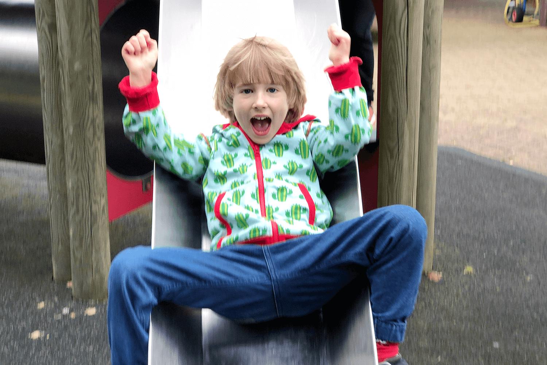 Toby enjoying the slide at the garden centre