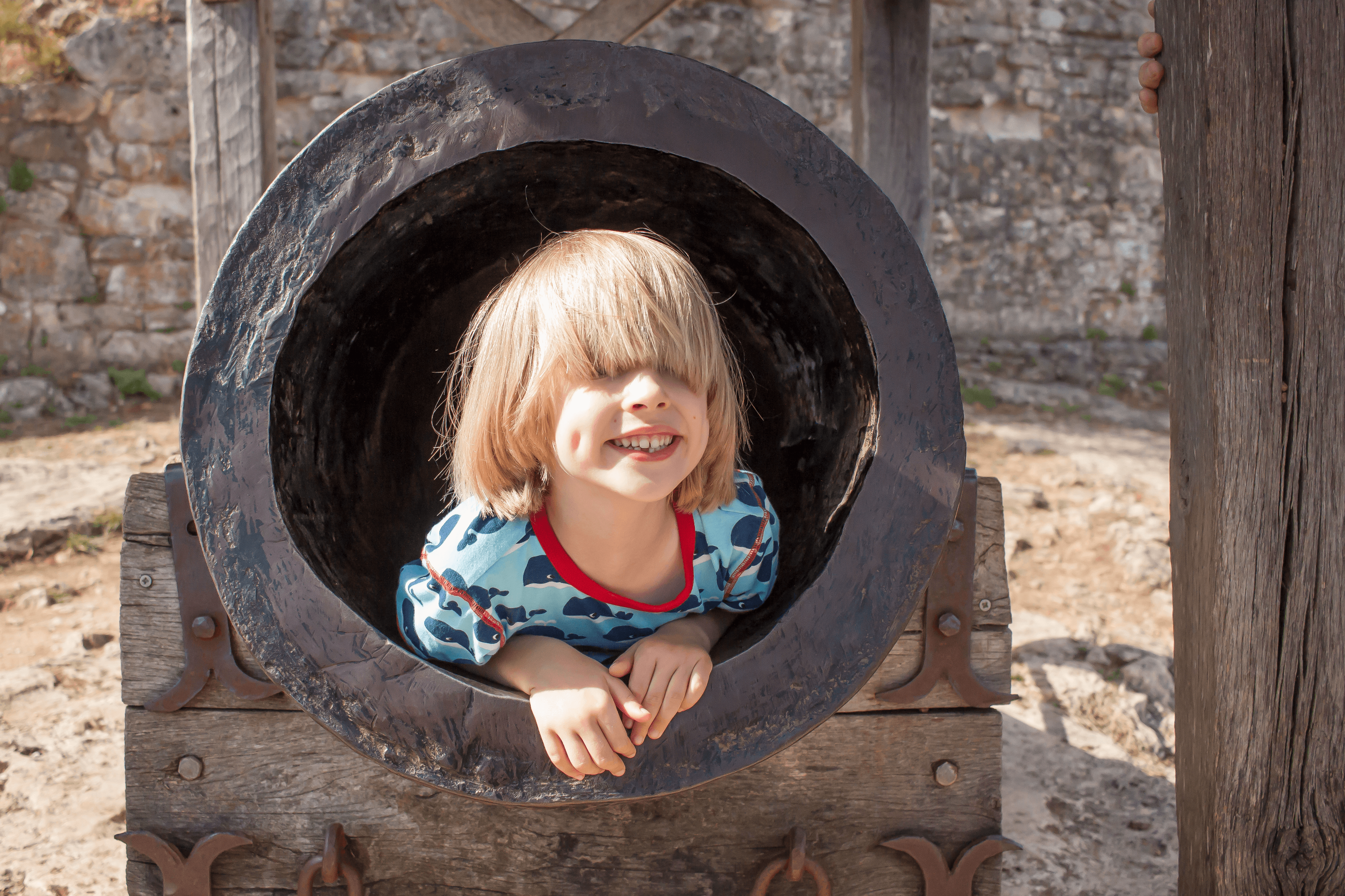 Toby inside a canon at Chateau de Castelnaud