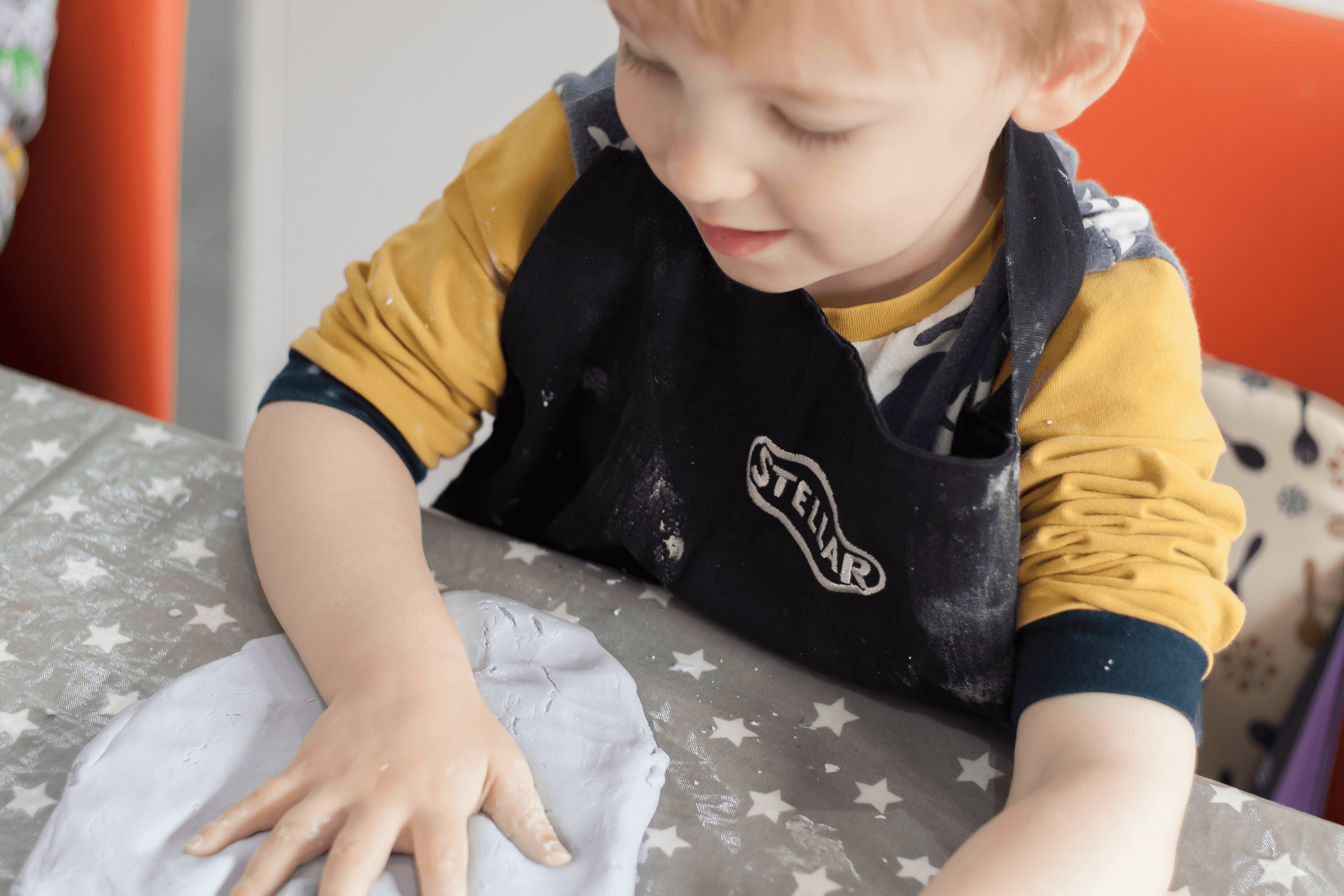 Gabe making hand prints in our homemade cloud dough