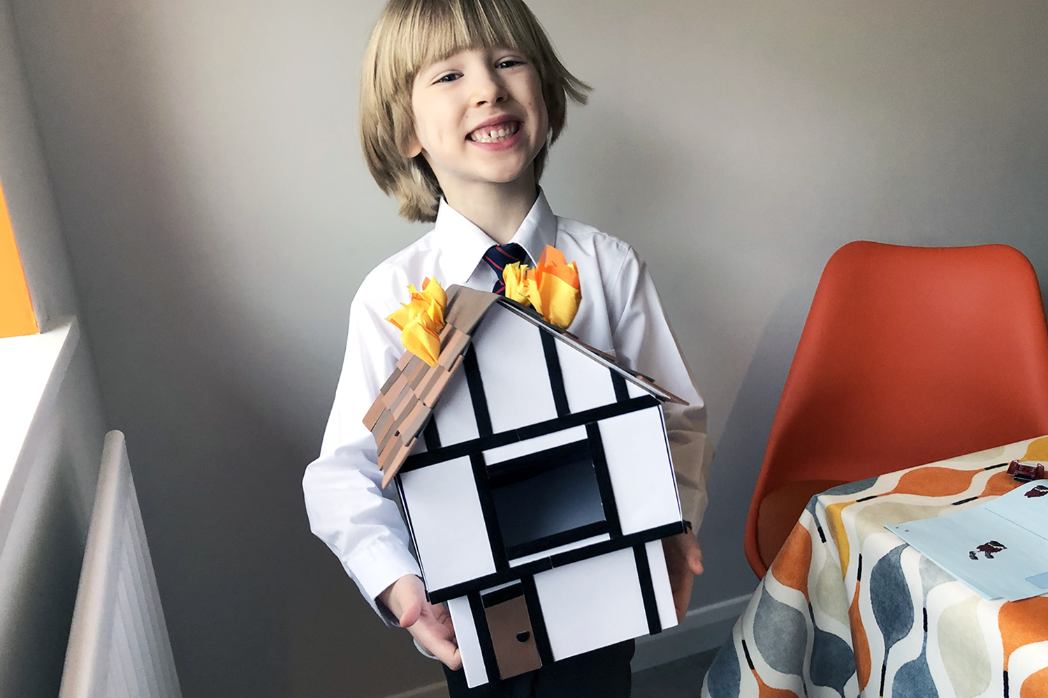 Toby with his Great Fire of London house