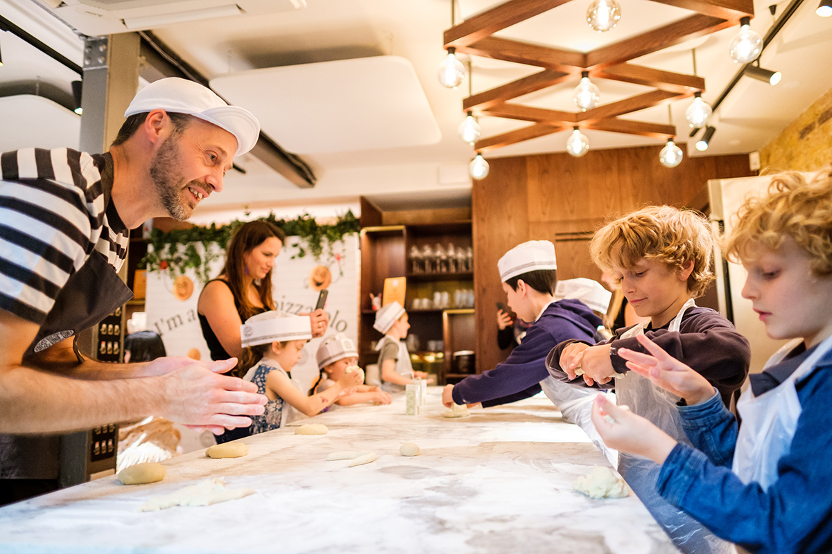 Kids creating their own pizzas at Pizza Express