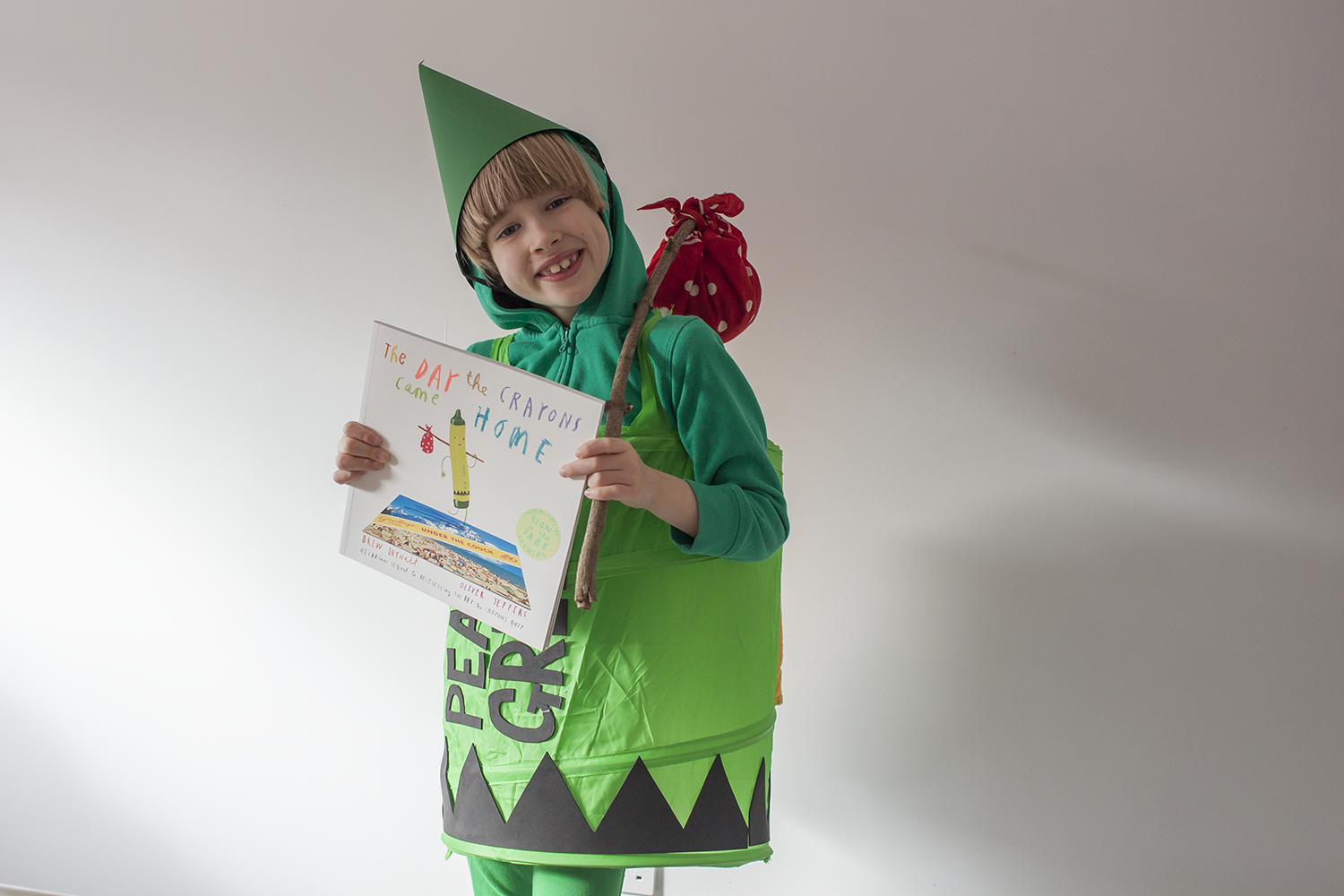 Toby dressed as Pea Green crayon from The Day the Crayons Came Home for World Book Day