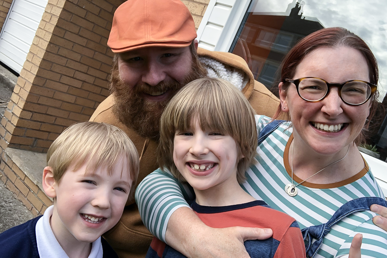 Family selfie outside our house