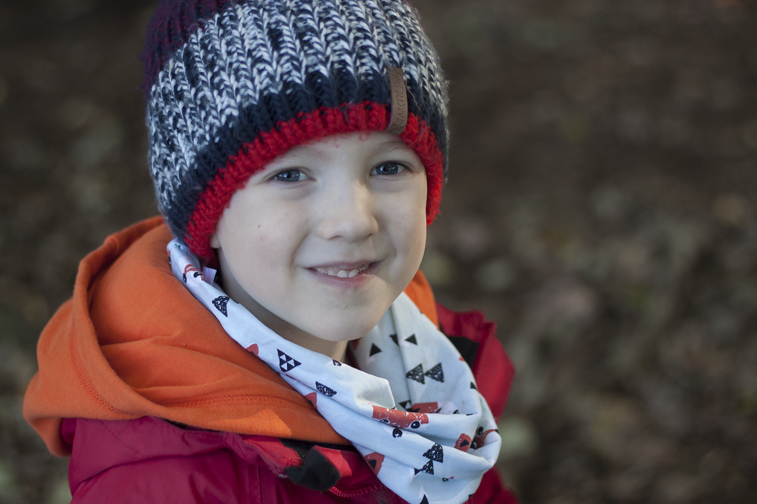 Gabe in his woolly hat in the woods