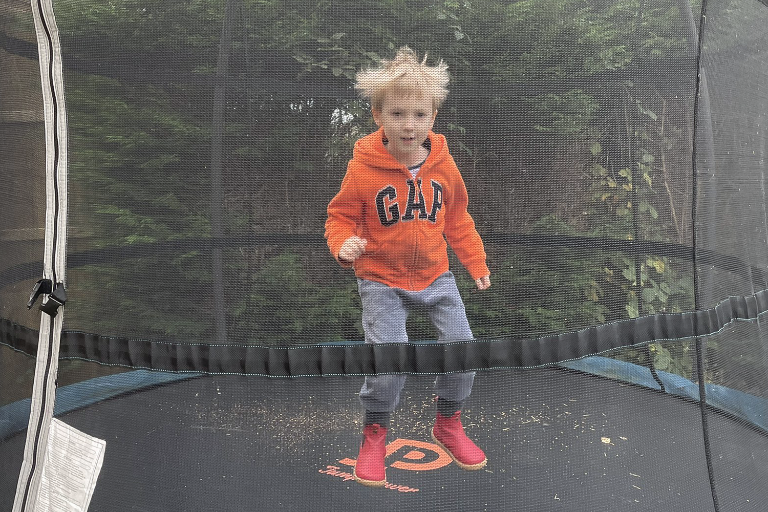 Gabe bouncing on the trampoline