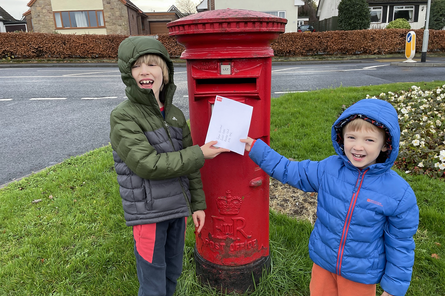 Toby and Gabe posting their letters to Father Christmas