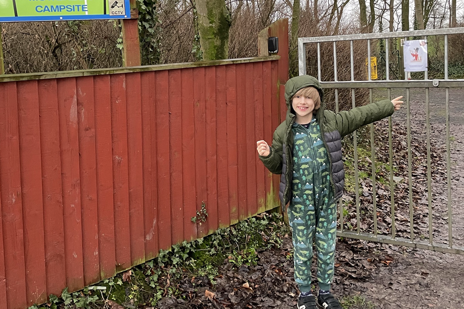 Toby pointing at sign on his Beaver Scout treasure hunt