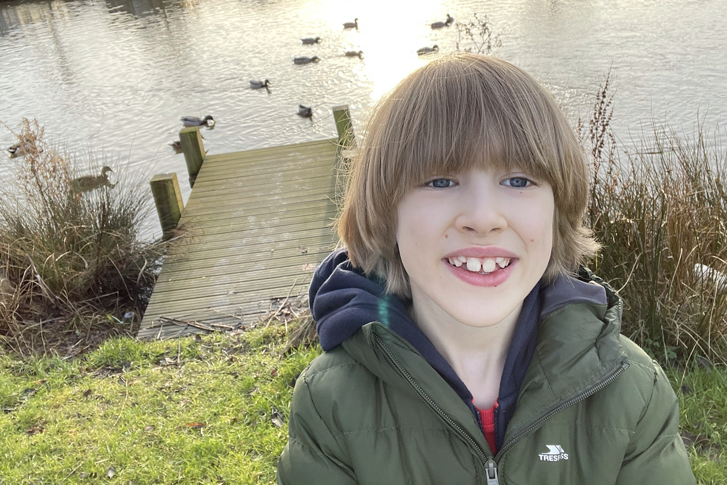 Toby with a duck pond behind him
