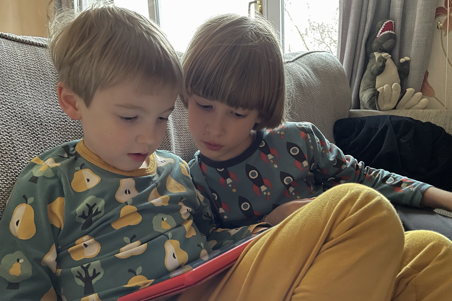 Toby and Gabe playing together on their tablet
