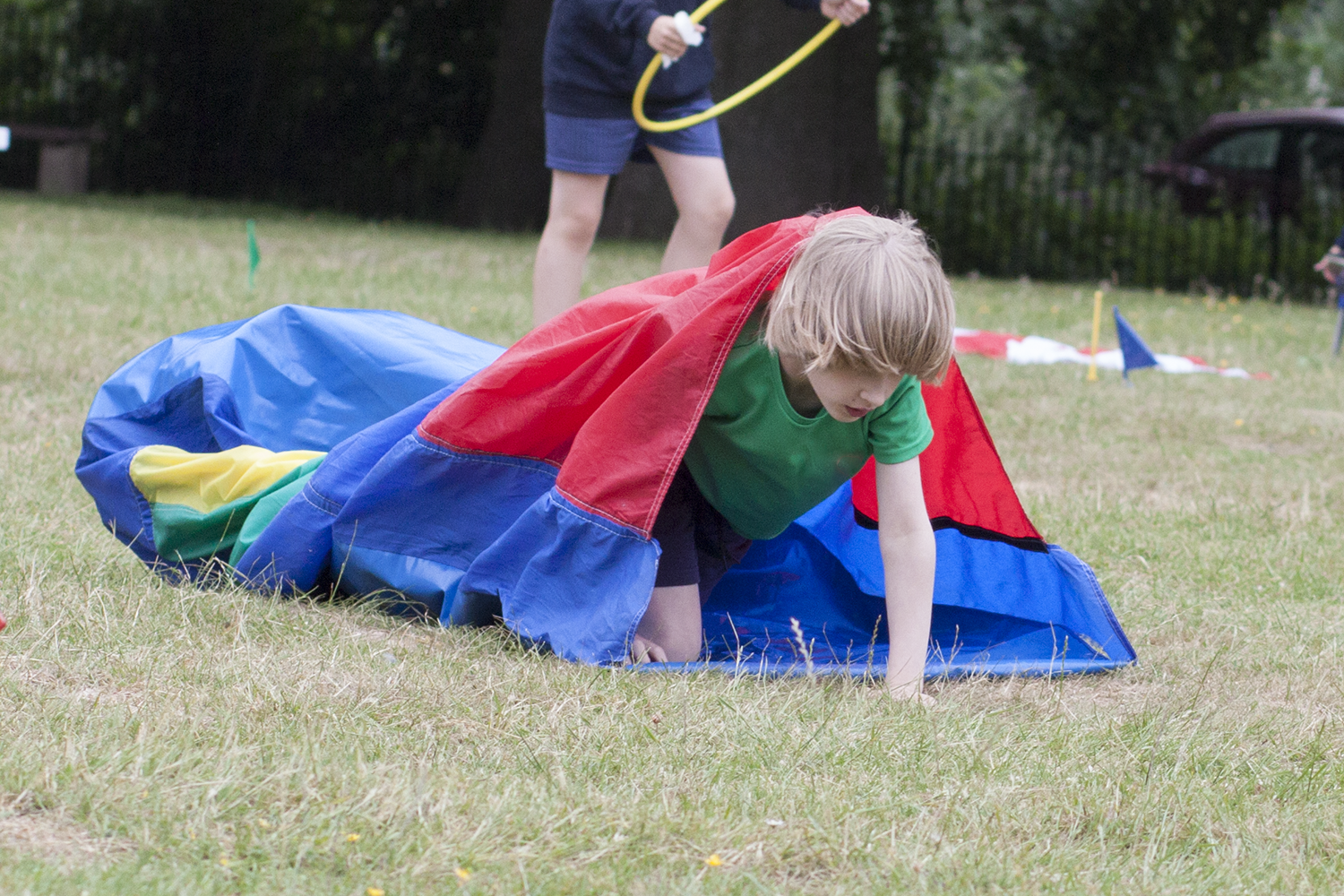 Toby coming out of a fabric tunnel on sports day