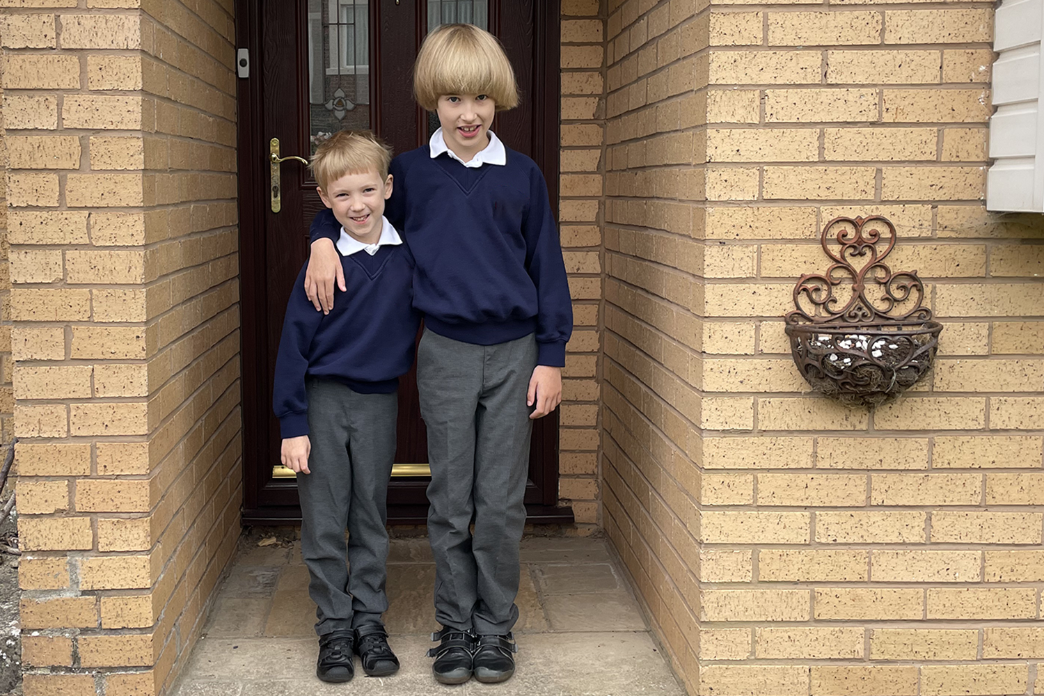 Toby and Gabe outside our front door on the first day of Year 4 and Year 2